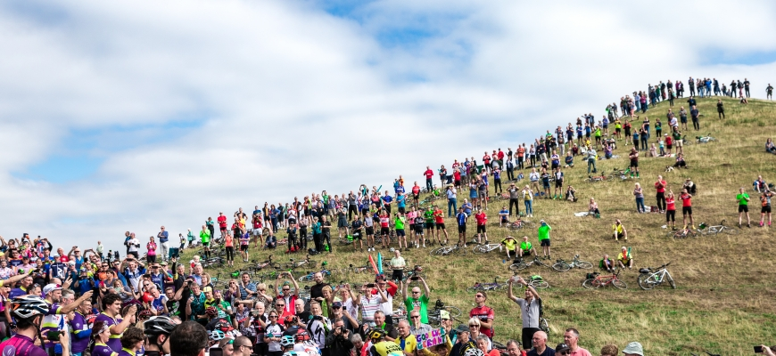 flashback to the crowds gathered to see riders at last year's OVO Energy Tour of Britain.